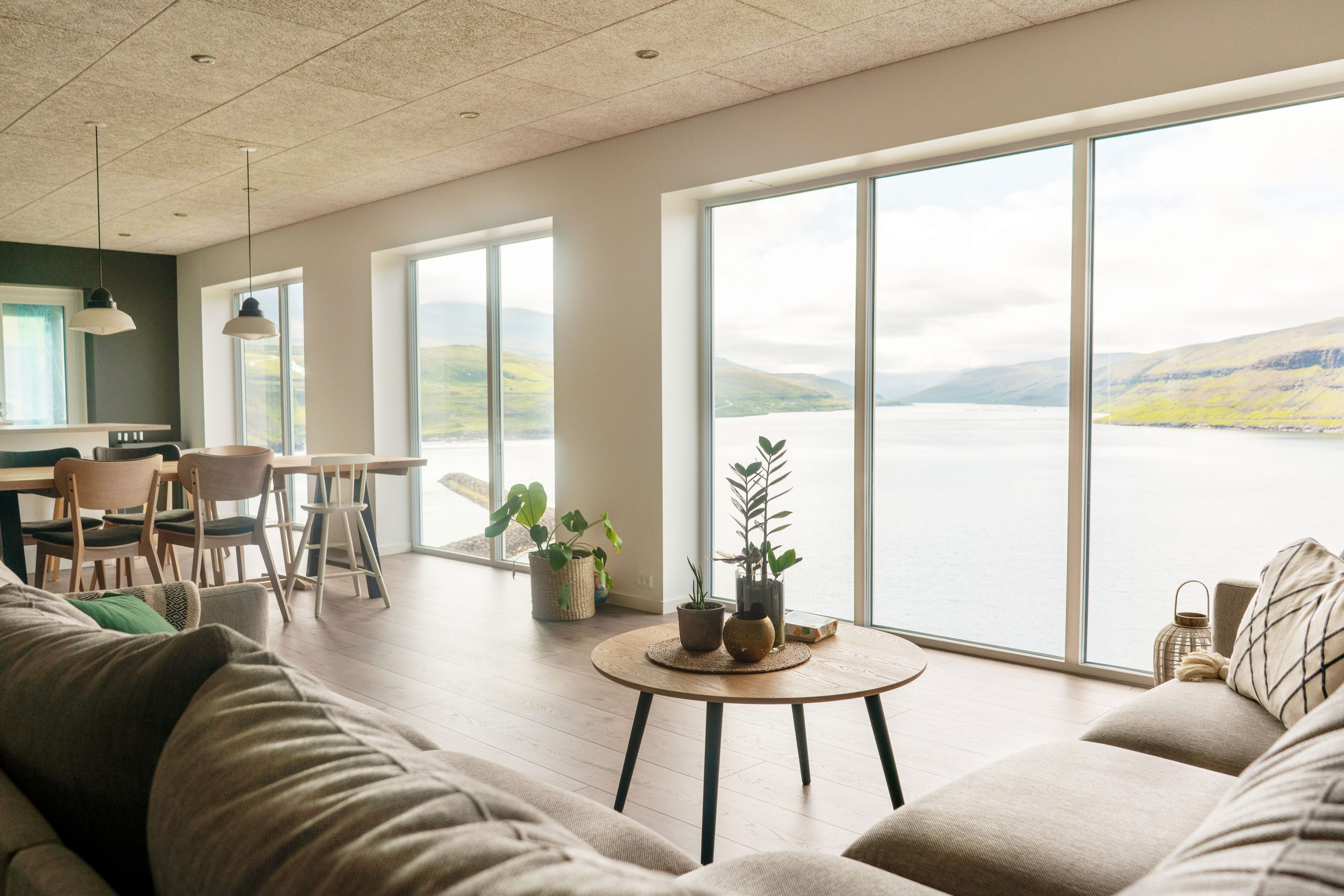Faroese living room with big window and view on fjord. Scandinav
